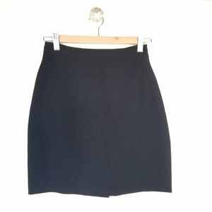 BEBE black mini skirt with slit on the back size 2